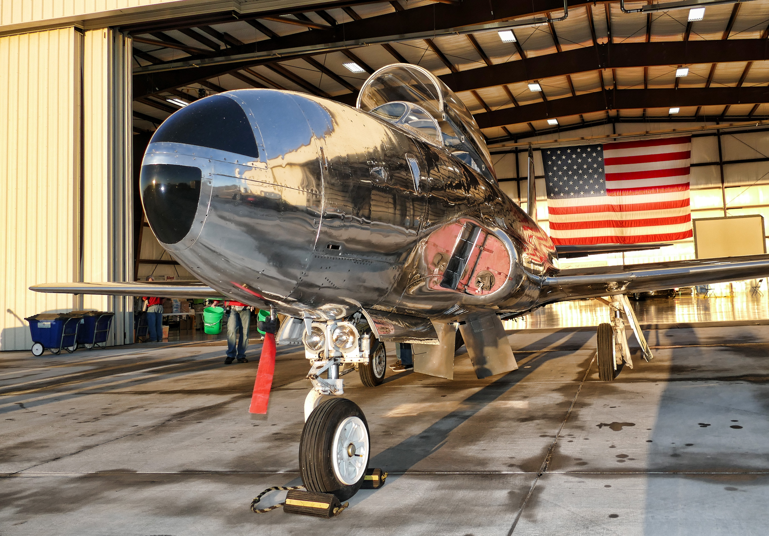 T-33 IN HANGAR WITH FLAG