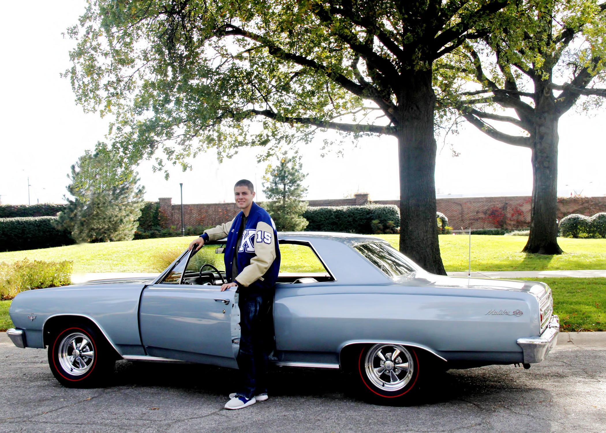 BRUCE_15_FULL_LENGTH_FIGURE_WITH_FULL_VIEW_OF_CHEVY