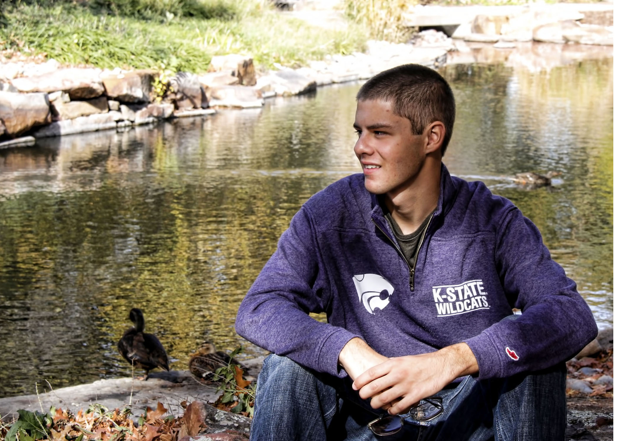 BRUCE_15_SETTING_ON_ROCKS_WITH_K_STATE_SHIRT